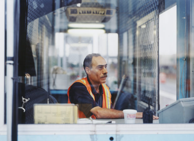 Matt Gunther Photographer Portraits ongshoreman-in-booth-sitting.jpg